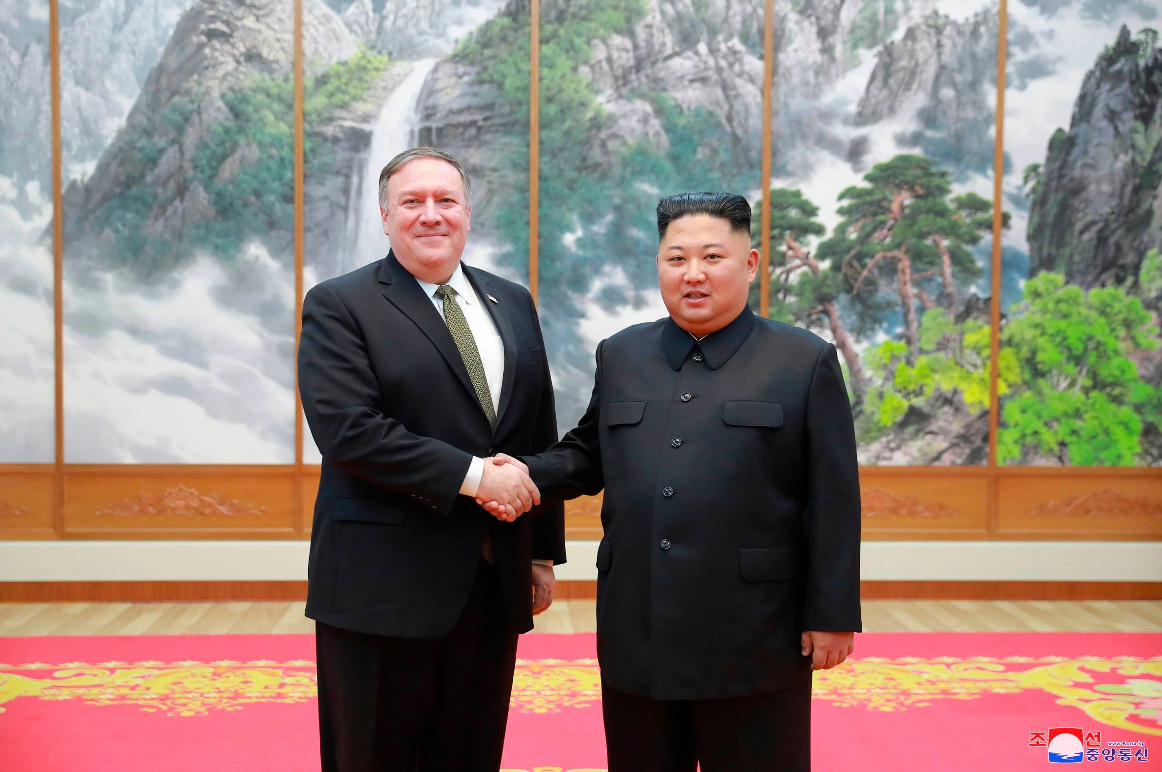 "Mandatory Credit: Photo by Uncredited/AP/REX/Shutterstock (9917104b) In this photo provided by the North Korean government, U.S. Secretary of State Mike Pompeo, left, shakes hands with North Korean leader Kim Jong Un as they pose for a photo in Pyongyang, North Korea, . Pompeo said that he and Kim made unspecified progress Sunday toward an agreement for the North to give up its nuclear weapons, though there was no immediate indication whether Pompeo had managed to arrange a much-anticipated second summit between Kim and President Donald Trump. Independent journalists were not given access to cover the event depicted in this image distributed by the North Korean government. The content of this image is as provided and cannot be independently verified. Korean language watermark on image as provided by source reads: ""KCNA"" which is the abbreviation for Korean Central News Agency Pompeo Asia, Pyongyang, North Korea - 07 Oct 2018"