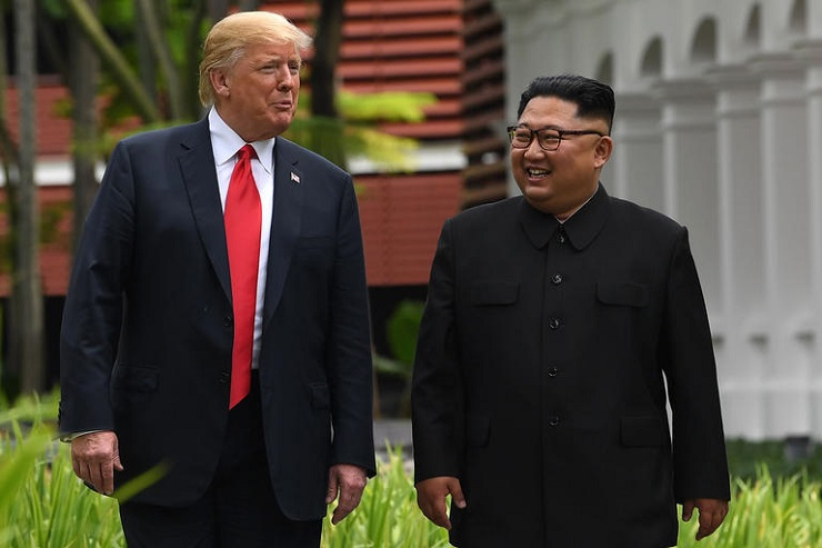 North Korea's leader Kim Jong Un (R) walks with US President Donald Trump (L) during a break in talks at their historic US-North Korea summit, at the Capella Hotel on Sentosa island in Singapore on June 12, 2018.  Donald Trump and Kim Jong Un became on June 12 the first sitting US and North Korean leaders to meet, shake hands and negotiate to end a decades-old nuclear stand-off. / AFP PHOTO / SAUL LOEBSAUL LOEB/AFP/Getty Images